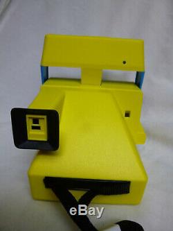 Polaroid 600 MTV Musical TV colored camera with brochure. MINT. Very Rare